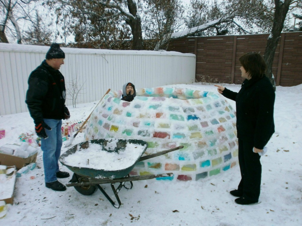 Couple Builds Incredible Igloo In Backyard Out Of Milk Cartons And Colored Water