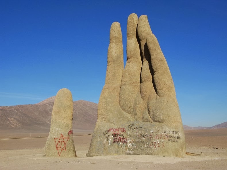he Has Several Similar Gigantic Hand Sculptures on Display at Various Locations Around The World