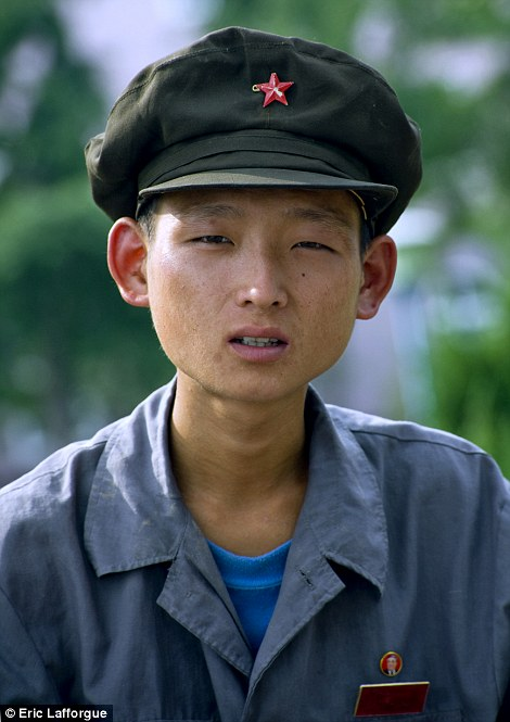 A North Korean soldier photographed by Eric Lafforgue.