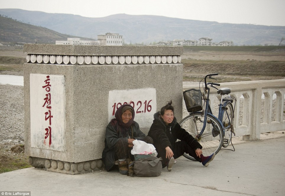 Taking pictures of people who ride their bikes for hours to get to work in North Korea is forbidden.