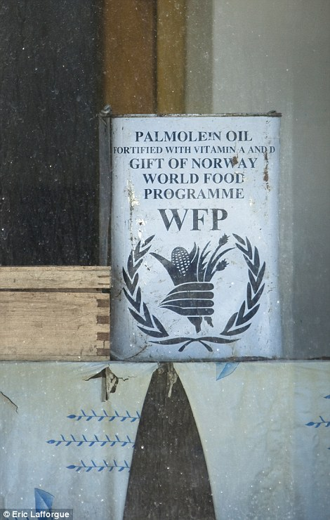 North Korea says foreign aid is a war debt and taking photos of any WFP sign is forbidden.